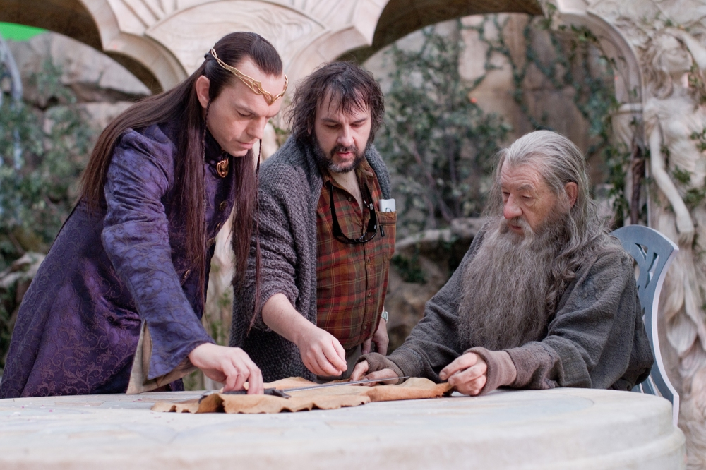 Peter Jackson directs Ian McKellen and Hugo Weaving on the set of The Hobbit..