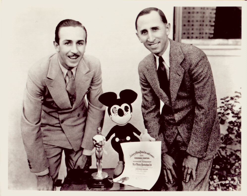 Walt and Roy Disney, with Mickey and one of many Oscar statuettes.