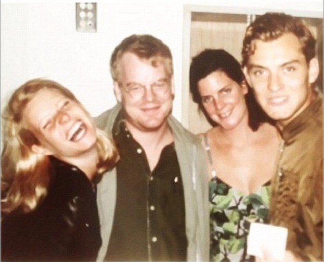 Hoffman, Paltrow, Law and friend, hanging out.