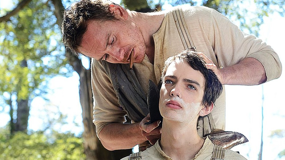 Michael Fassbender as Silas and Kodi Smit-McPhee as Jay.