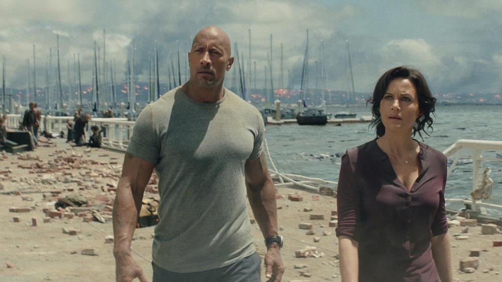 Dwayne Johnson and Carla Gugino in San Andreas.