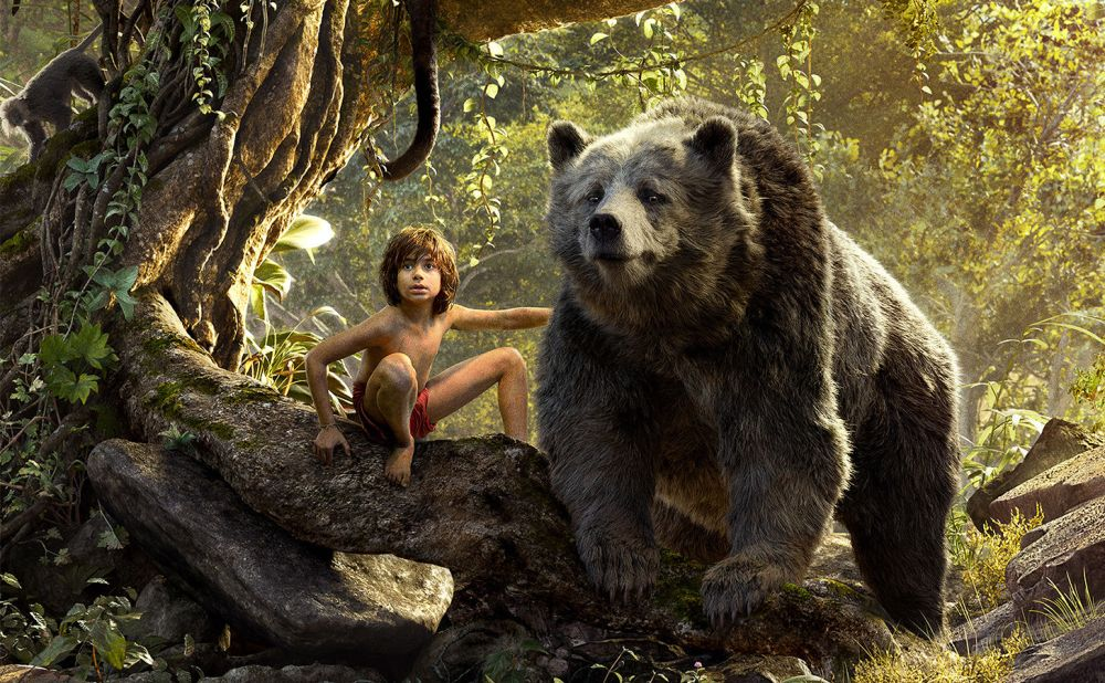 Neel Sethi as Mowgli and Bill Murray as Baloo.