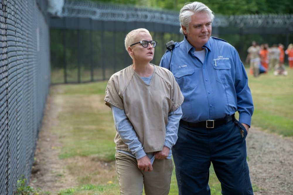 Lori Petty as Lolly and Michael Harney as Sam Healy.