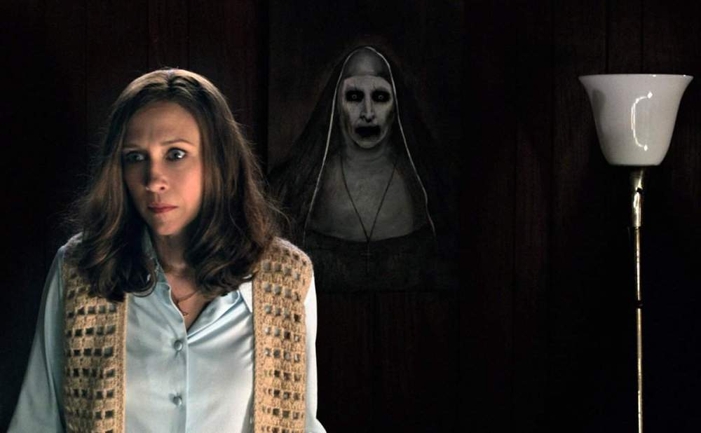 Vera Farmiga as Lorraine Warren.