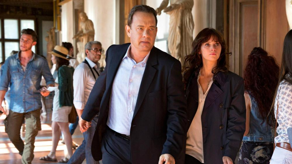 Tom Hanks as Robert Langdon and Felicity Jones as Dr. Sienna Brooks.