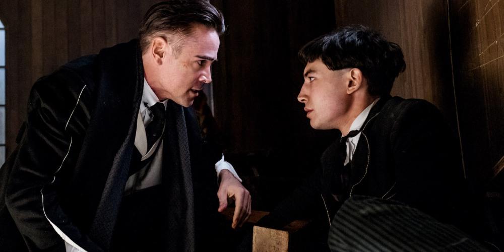 Colin Farrell as Percival Graves and Ezra Miller as Credence.