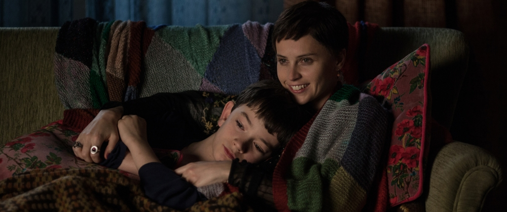 Lewis MacDougall as Conor O'Malley and Felicity Jones as Lizzie Clayton.