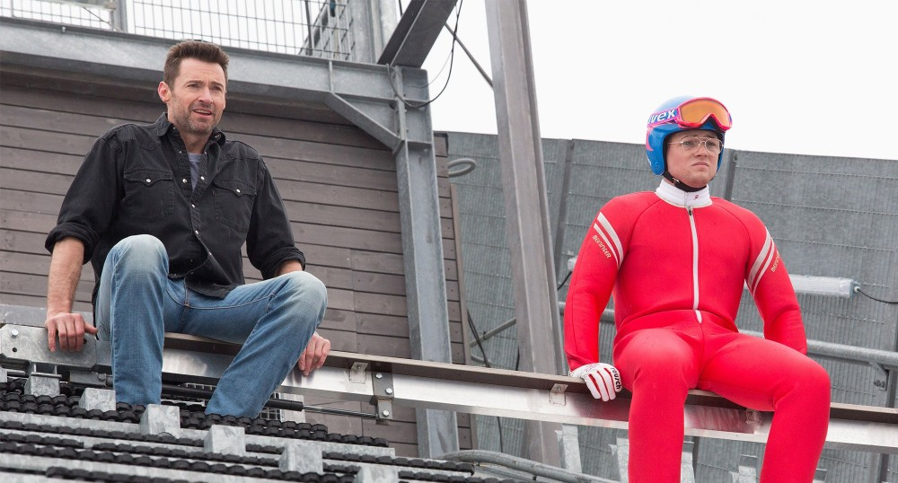 "Hugh Jackman as Bronson Peary and Taron Egerton as Eddie ""The Eagle"" Edwards."