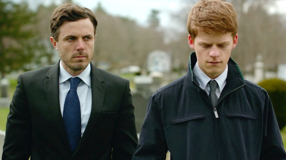 Casey Affleck as Lee Chandler and Lucas Hedges as Patrick Chandler.